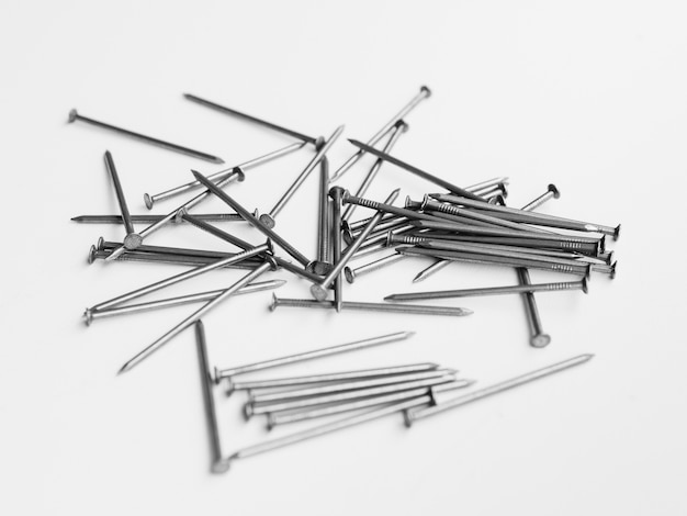 Pile of nails on white table