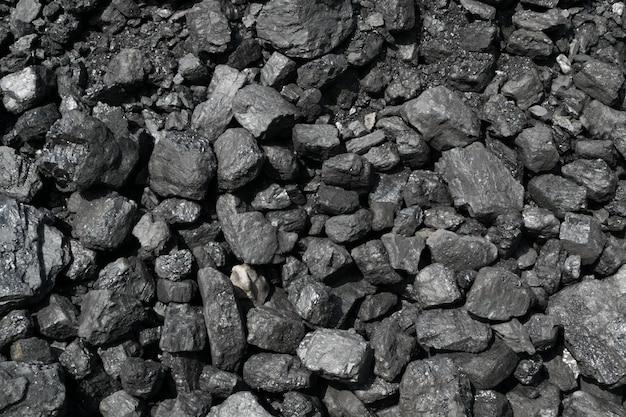 Pile of natural black hard coal or diamond coal background