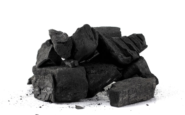 Pile of natural wood charcoal isolated on white background