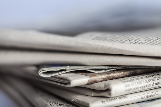 Pile of newspapers on  background close up