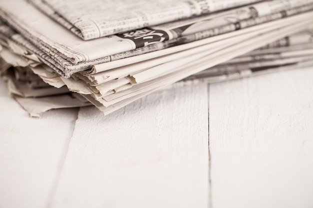 Pile of newspapers on a white table