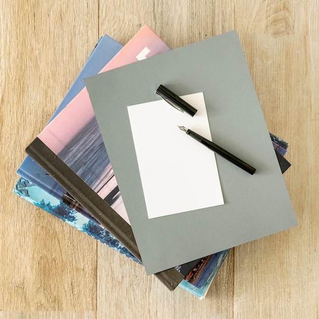 Pile of notebooks on wooden background
