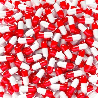 赤い錠剤や医療カプセルの山