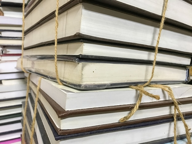 Pile of old books with rope background