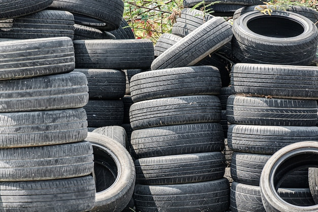 Pile of old car tires on the ground