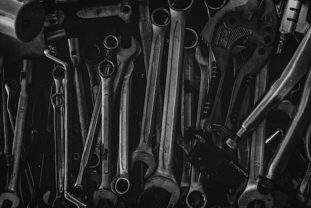Pile of old wrench. mechanic tools. closeup set of spanner in tool box. chrome wrench at garage workshop.