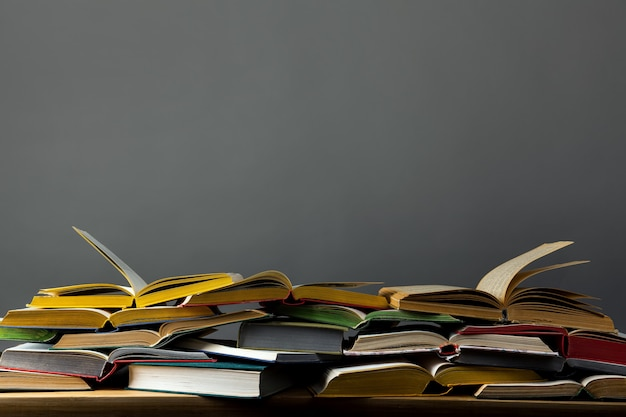 Pile of open books on the table