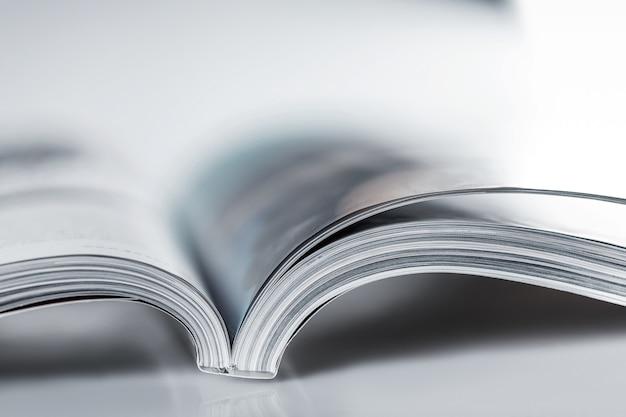Pile of open magazines, blue toned image