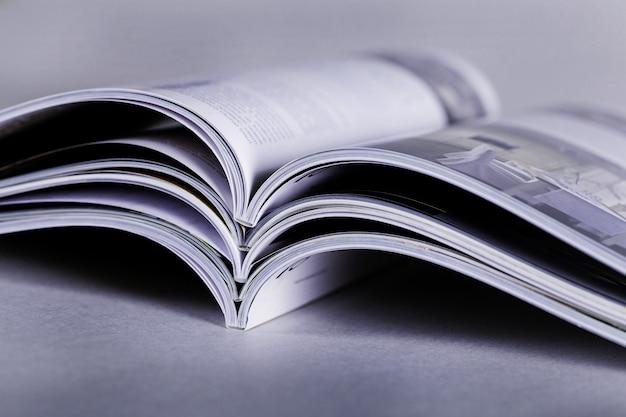 Pile of open magazines, toned image