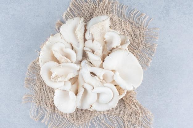 Pile of oyster mushroom on sack.
