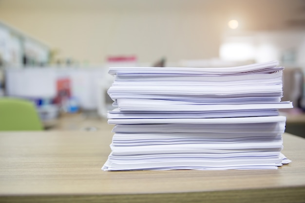Pile of a paper on office desk stacked.