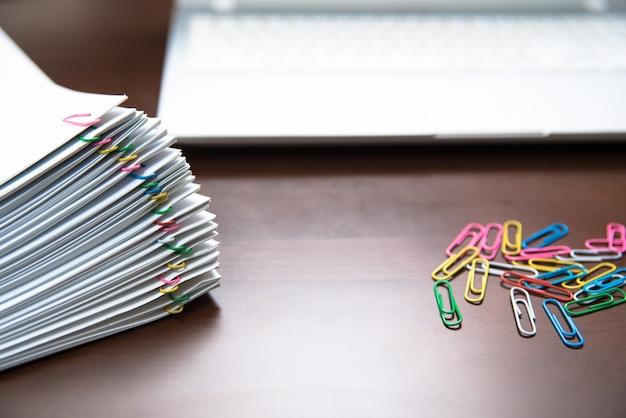 Pile of paper with colorful clips.