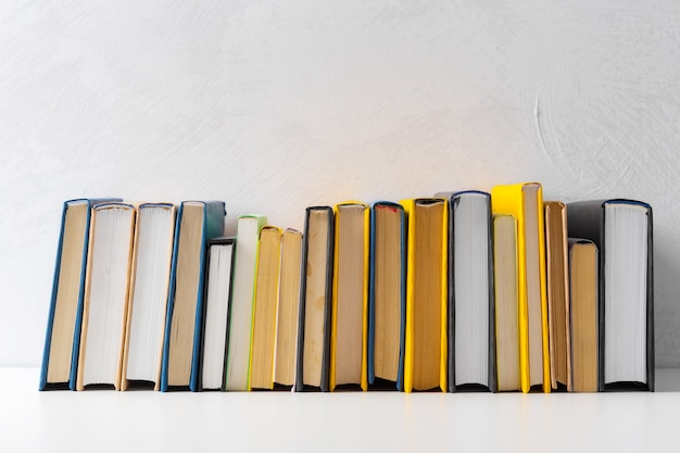 Pile of paperback books on a table