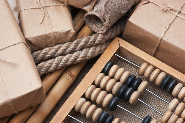 Pile parcel wrapped with brown kraft paper and abacus