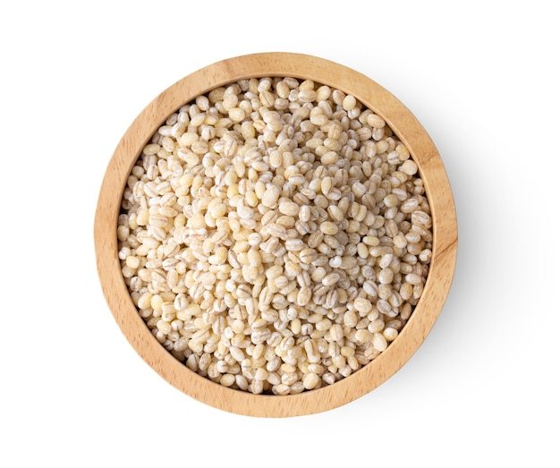 Pile of pearl barley isolated on white background