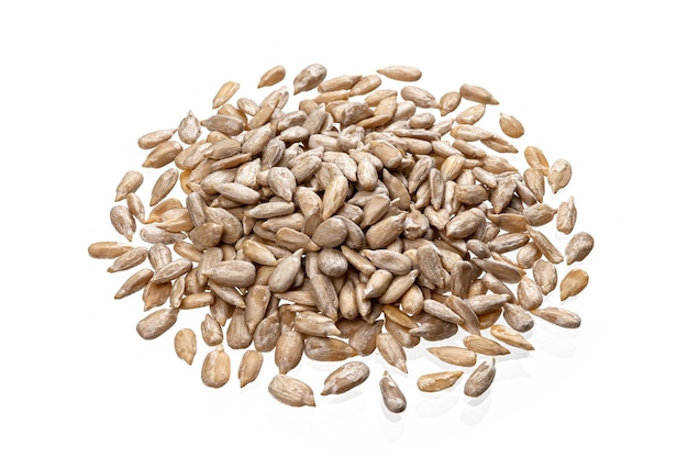 Pile of peeled sunflower seeds isolated on white table