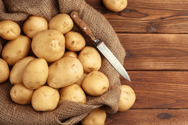 Pile of potatoes lying on wooden boards