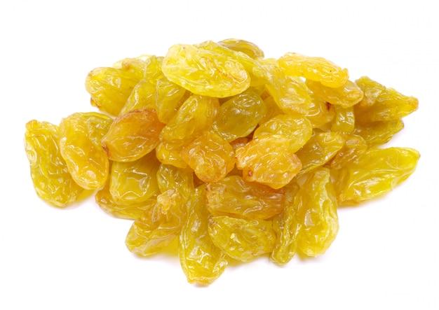 Pile of raisins on white isolated