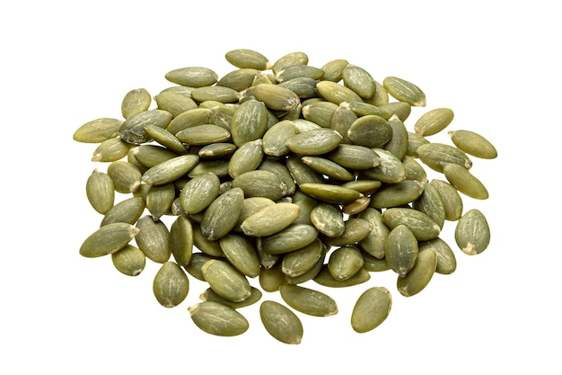 Pile of raw peeled pumpkin seeds isolated on white table