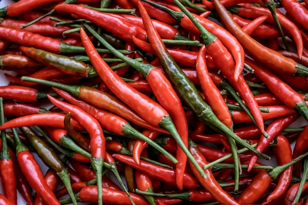 Pile of red hot chillies background and pattern