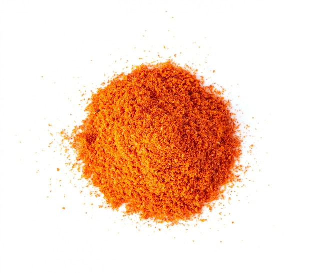 Pile of red paprika powder isolated on white background. top view
