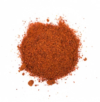 Pile of red paprika powder on white background