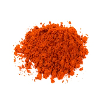 Pile of red pepper powder isolated on white background