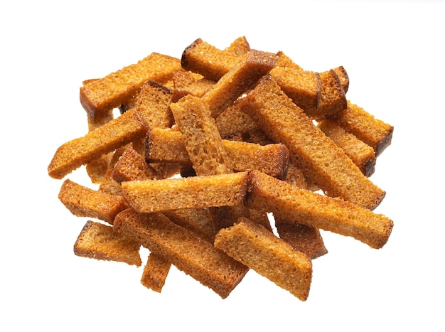 Pile of rye bread croutons, salted crispy bread sticks isolated on white background