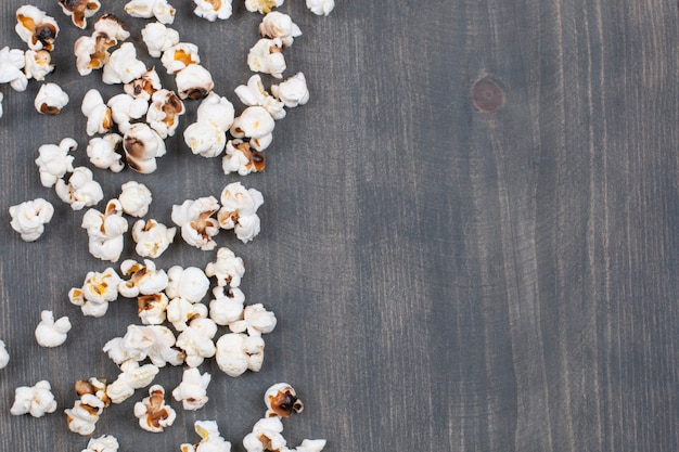 Pile of salted popcorn on wooden surface