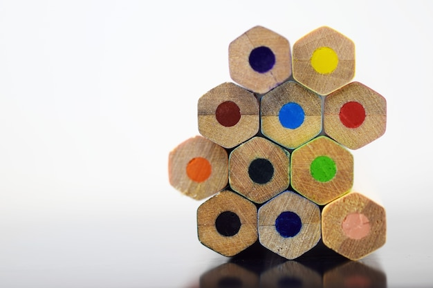 Pile of sharp coloured drawing pencils on table