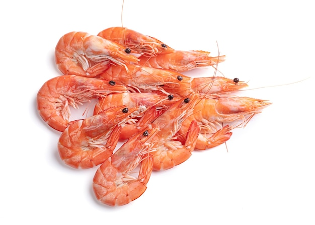 Pile of shrimps cut out on a white surface