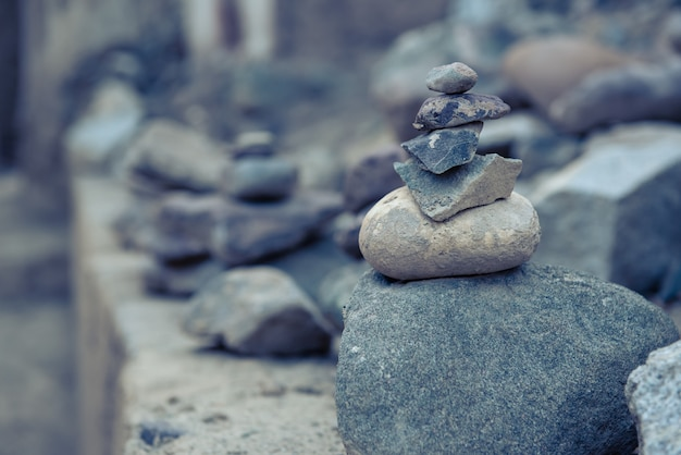 Pile stacked of zen stones in the nature.