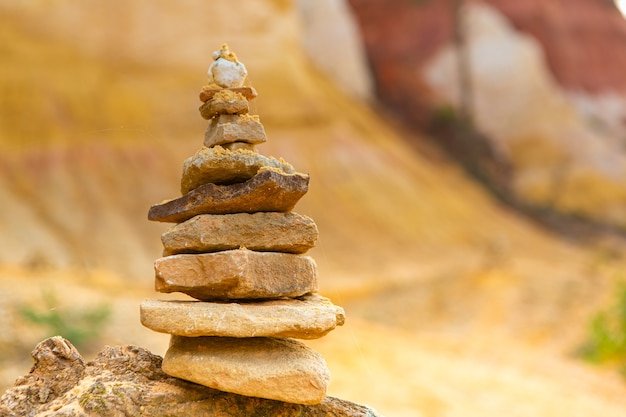 Pile of stones in balance land art in nature
