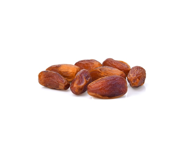 Pile of tasty dry dates isolated on white background