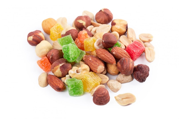 Pile of toasted nuts and candied fruit isolated