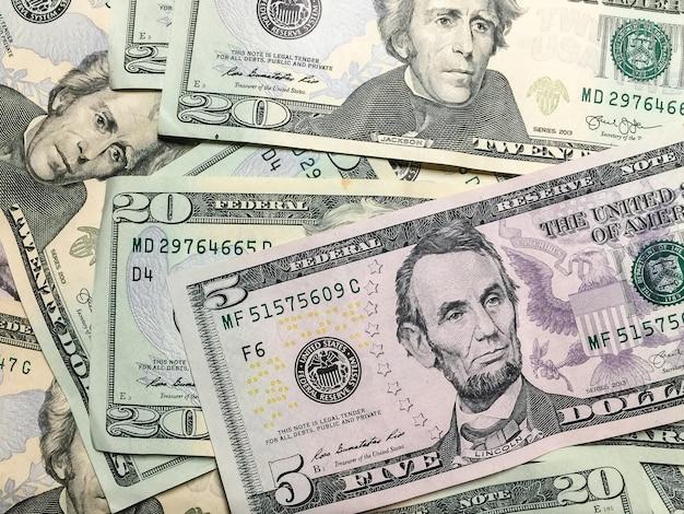 Pile of united states five-dollar bill and twenty-dollar bills