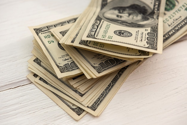 Pile of us dollar bills, savings concept