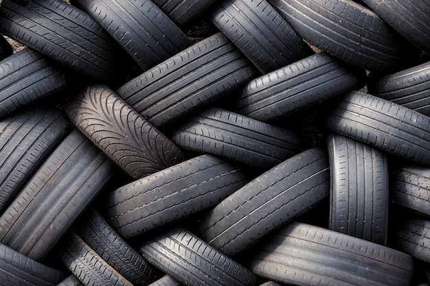 A pile of used car tires stacked