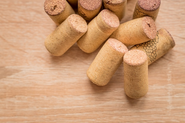 Pile of used vine corks on wooden with copy space