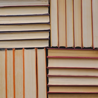Pile of vintage paper orange books in hard cover. fall reading list.