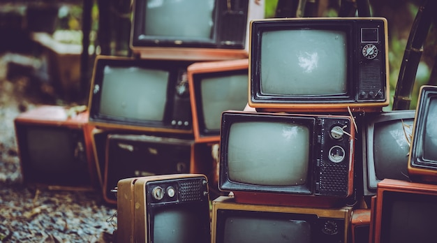 Pile of vintage portable television
