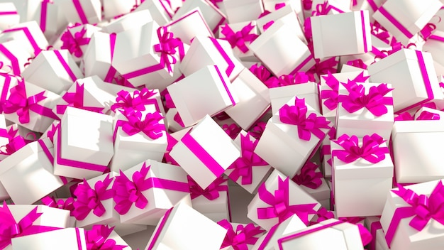 Pile of white gift boxes with pink ribbons