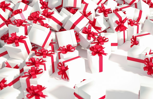 Pile of white gift boxes with red ribbons on a white background