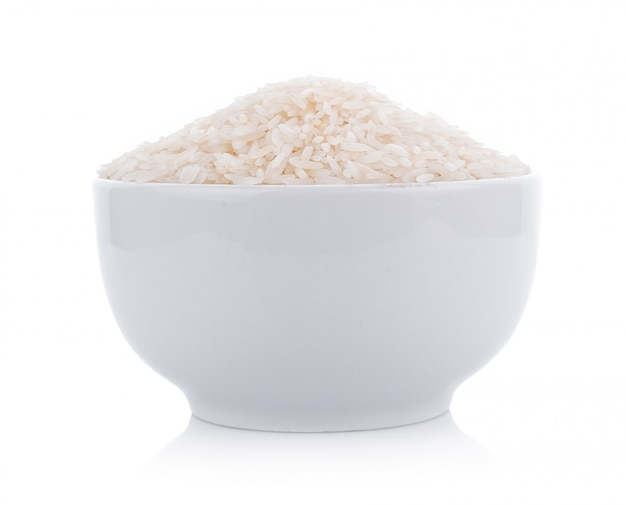 Pile of white rice in bowl on white