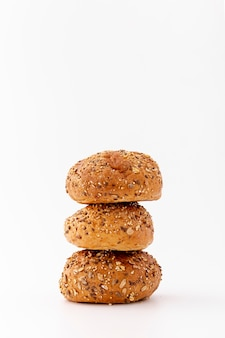 Pile of wholegrain baked buns on white background