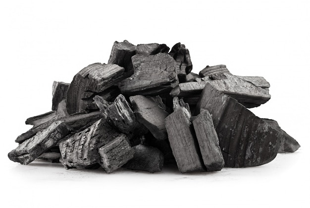 Pile of wood coal isolated on white