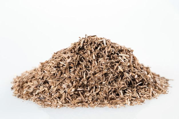 Pile of wood smoking chips isolated on white.