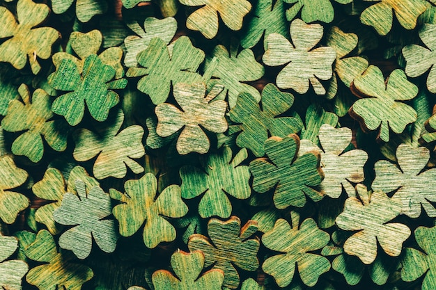 Pile of wooden green four-leaf clovers