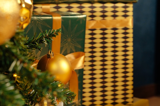 Pile of wrapped green and gold presents for christmas