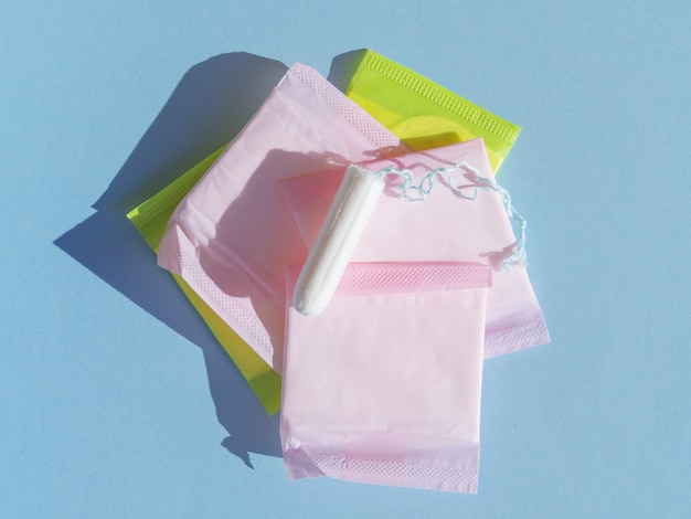 Pile of wrapped pads and tampon top view